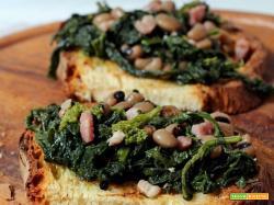 crostoni di pane di Matera con cime di rapa e fagioli di Sarconi
