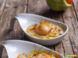 Passatina di fave e cicerchie con capasanta dorata all'arancia e petali di mandorle tostate