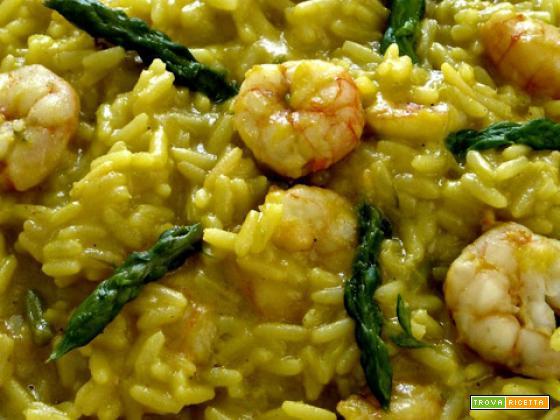 Timballi di riso al curry con asparagi, gamberi e champagne