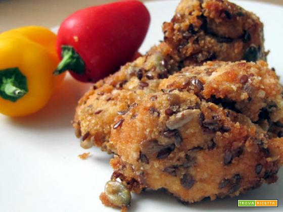 Bocconcini di pollo con panatura di semi vari