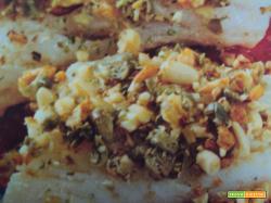 Filetti di nasello al trito di noci e pinoli