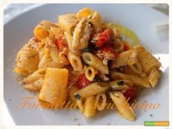 Insalata di pasta tiepida con spigola, vernaccia e olio Corriasall'arancia