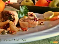 Calamari farciti con mele pomodori secchi e noci su crema di peperone
