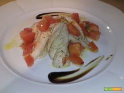 Filetti di cernia con cubetti di pomodoro e pepe