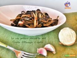 Cicoria fritta in padella, aglio, cipolla