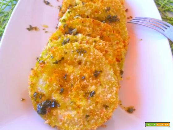 Zucchine impanate con prezzemolo e olio fatta al forno