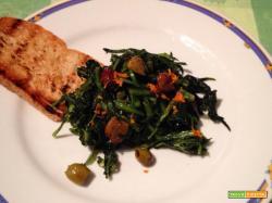 Cicoria ripassata con olive taggiasche e zeste d'arancia