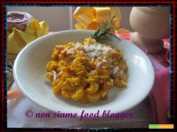 Pasta risottata con zucca mantovana, crudo toscano e ricotta salata sarda