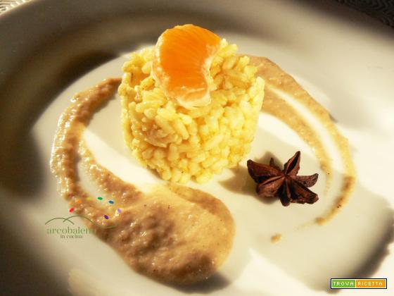 Risotto con polpa di Mandarini guarnito con crema di Pane al profumo di Anice Stellato