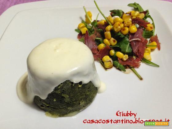 Flan di spinaci e taleggio con crema di parmigiano ed insalatina di rucola, bresaola e mais