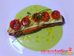 Crostone di pane con Asiago, julienne di cuori di carciofini sott'olio casarecci e pomodorini confit su crema di fave e ricotta