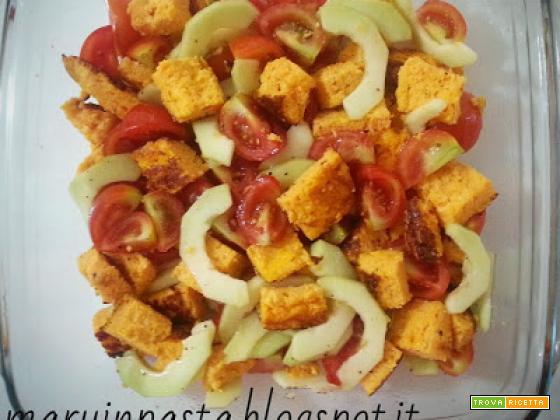 Frittatina di carote in insalata con pachino e cetrioli al profumo di basilico
