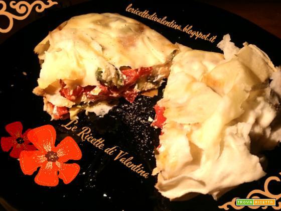 Scrigni di pane carasau ripieni di verdure salatate, caprino e olive taggiasche