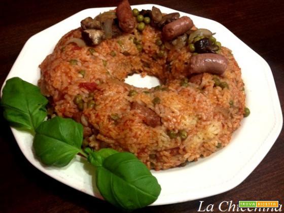 Anello di riso funghi, piselli e salciccia