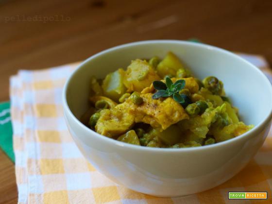 Pollo con piselli, patate e spezie