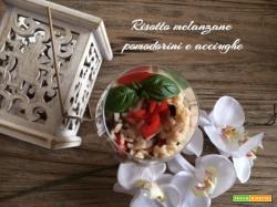 Risotto melanzane, pomodorini e acciughe
