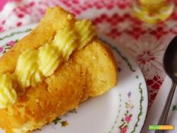 Babà con crema e bagna al limoncello, molto fresca e gustosa
