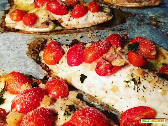 Filetti di orata gratinati al forno con pomodorini