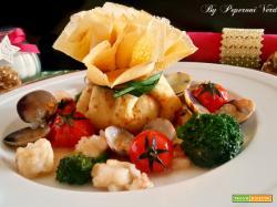 Fagottini di crepes con ricotta broccoletti e frutti di mare