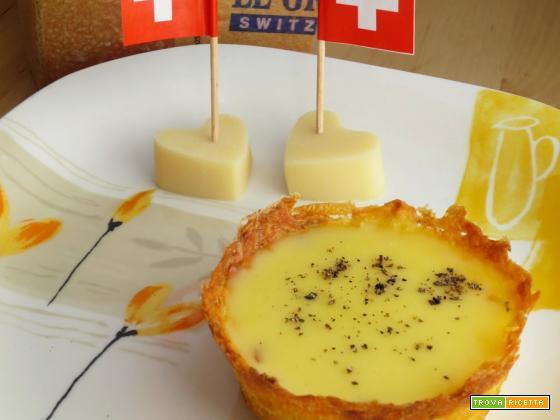 Cestini di patate con fonduta di Gruyère al tartufo nero