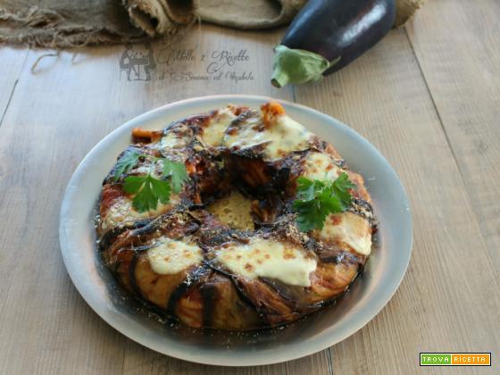 Ciambella di pasta al sugo filante con melanzane,Fornetto Versilia e classico
