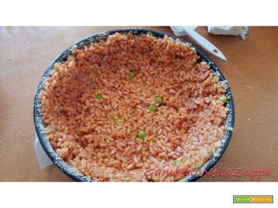 Sartù di riso con spatola, zucchine, polpettine di olive e zucchine e pisellini freschi