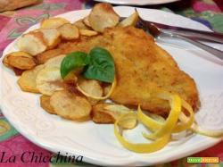 Filetti di platessa fritti alla birra e limone con chips di patate