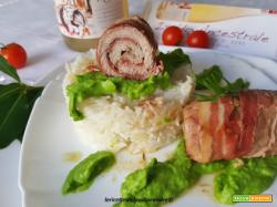 Rotolini di filetto di vitello al Ancestrale con fondo Iseldo con riso basmati su crema di piselli