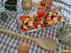Polpo con pomodorini, olive e capperi