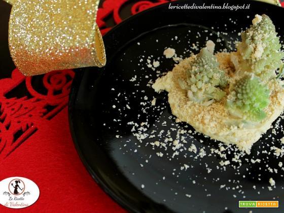 Boschetto innevato, broccolo romanesco su hummus di ceci con spolverata di nocciole
