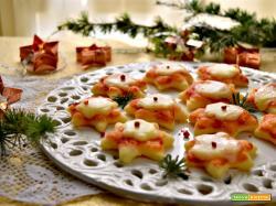 Pizzette a forma di stelle, un antipasto natalizio
