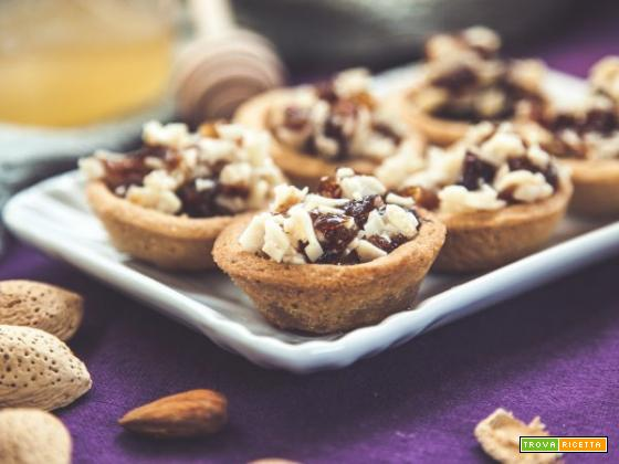 Tartellette con ricotta, mandorle e miele : un mix di dolcezza
