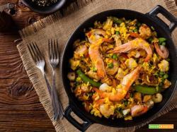 Paella, il sapore e il profumo della tradizionale ricetta spagnola