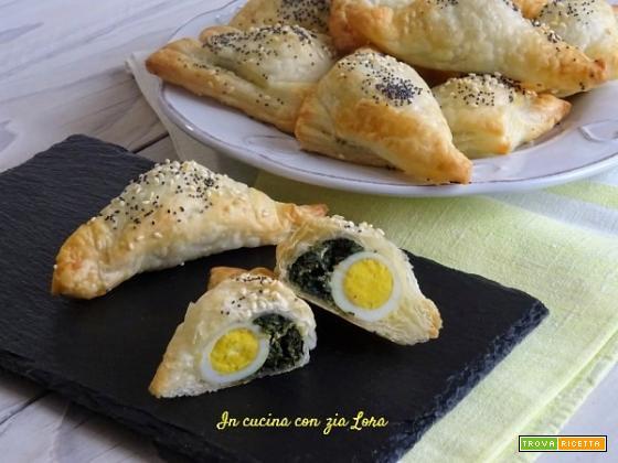 Antipasto di pasta sfoglia erbette e uova di quaglia