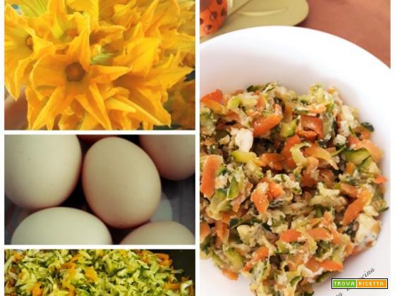 Uova strapazzate con zucchine, fiori di zucca e carote