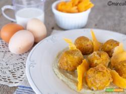 Gnocchi di pane allo zafferano su crema di carciofi con chips di lenticchie