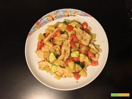 Petti di pollo con patate,zucchine,pomodori e curry