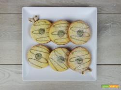 Biscotti occhio di bue con crema al pistacchio