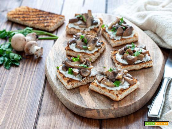 Crostini ai funghi con ricotta e olio al tartufo